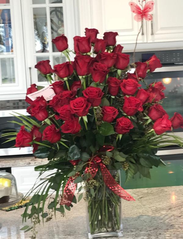 """""""6 dozen long stem red roses"""""""