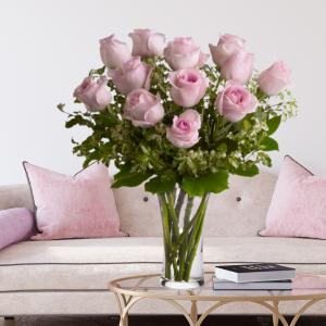 """dozen pink roses in vase"""